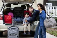 Family at car preparing for road trip