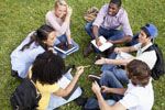 College students sitting in grass