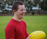 Teen boy with a football