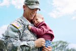 Military dad with child