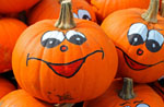 Pumpkins with painted smiling faces