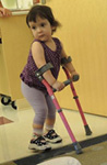 Girl using crutches