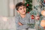 Boy by Christmas tree