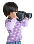 Kid looking through binoculars