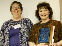 Cathy Haarstad Gives Award to Joan Karpenko